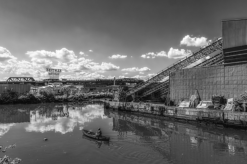 Rower on the Gowanus Canal,  2012; Archival pigment print, 32 x 48 inches