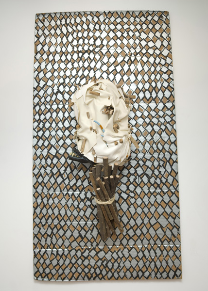 Eaassst  2013 Pleather, wood, bicycle inner tubes, acrylic, fake teeth, chicken wire, cardboard, and twine 71 x 38 x 13 inches