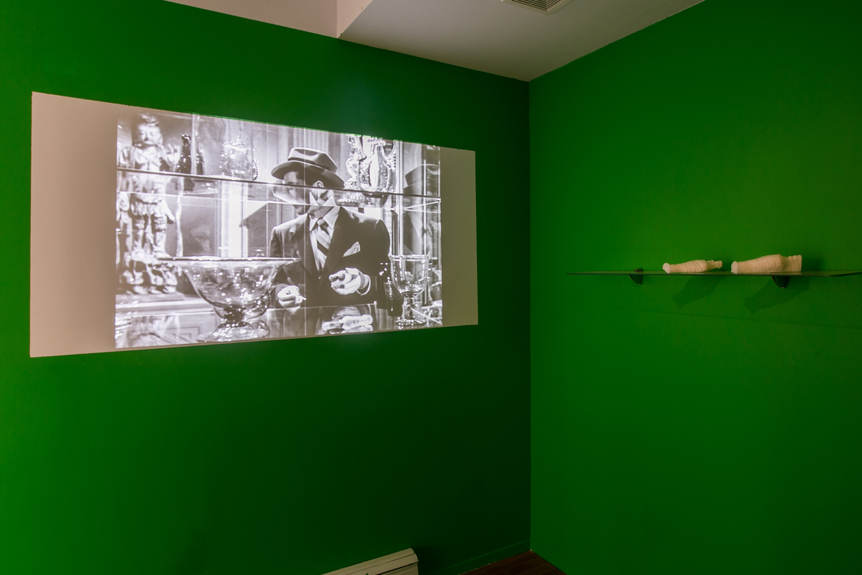 Izabela Gola   Thresholds  , installation view   2014   Video, sound, oil painting, sculptural wax, glass, wall paint, combined media   Dimensions variable
