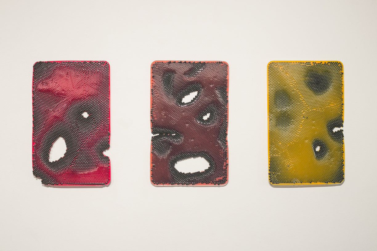 Jesse Greenberg From left to right:  Plate Set, Red Pox; Plate Set, Rose Pox; Plate Set, Yellow Pox  2014 Urethane plastic, pigment, ABS plastic 17 x 11 inches each