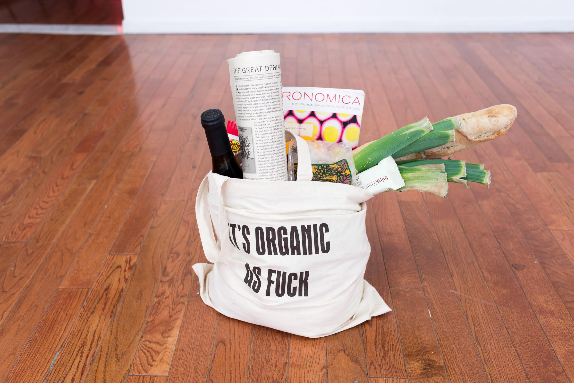 Floor: Søren Aagaard,  It's Organic As Fuck [Tabletop Dolly Edition] , 2015. Customized tote bag, organic leeks, onions, Lifestyle magazine, Jelly Beans, California wine, Trader Joe's products, and more. Dimensions variable.