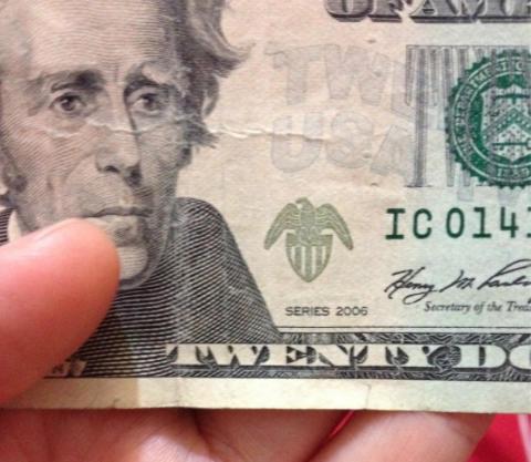 Slightly ripped bills: a no-no in Peru. (iPhone photo: Connie Tsang)