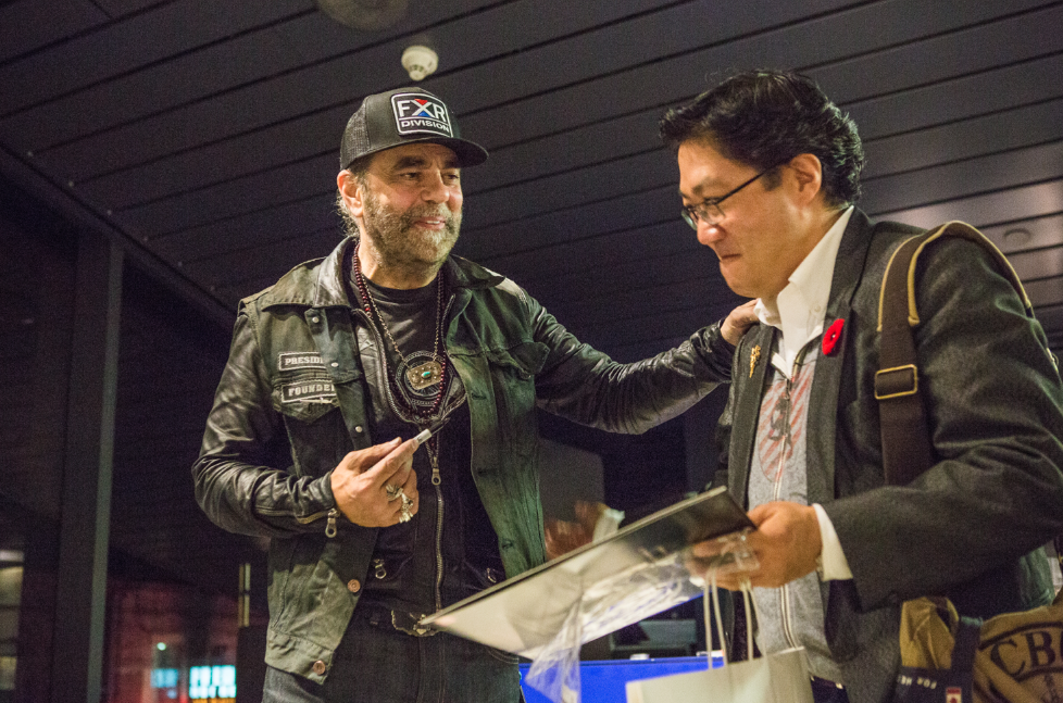 Daniel Lanois signing autographs (Photo: Connie Tsang for TIFF)