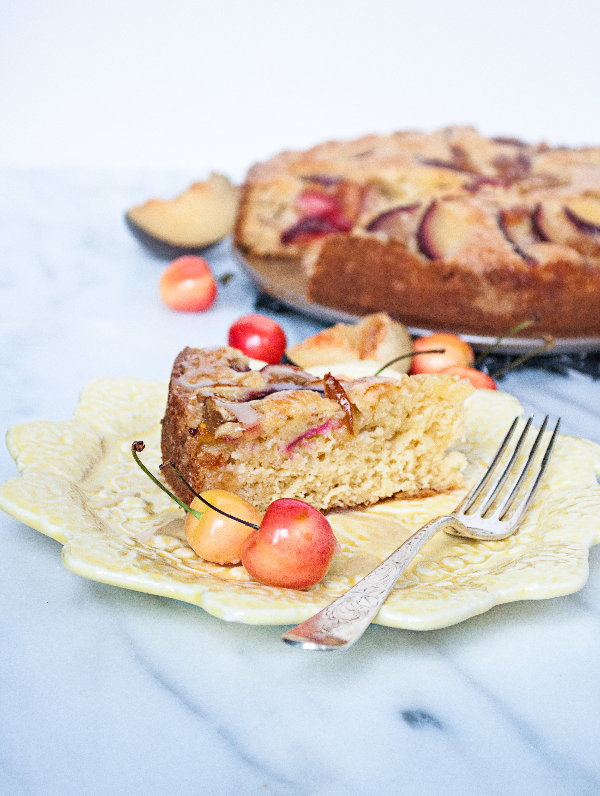 Yogurt Cake with Black Plums and Cherries and a Honey Lemon Glaze
