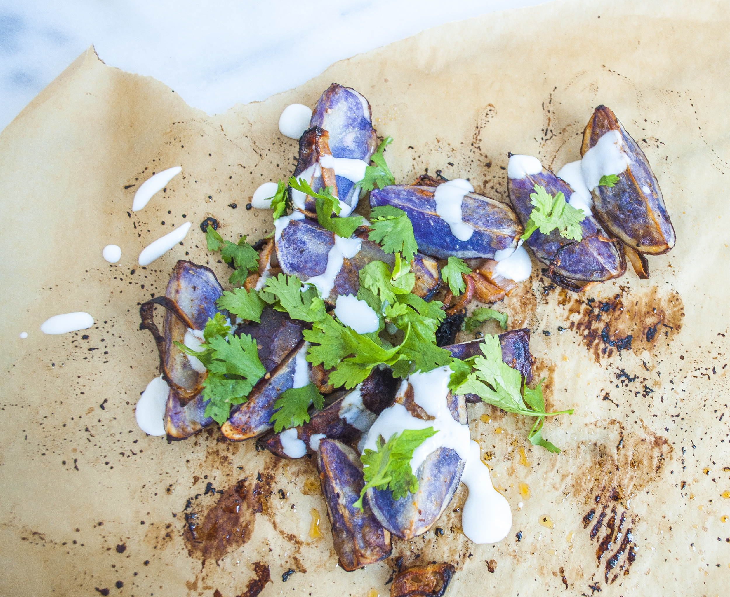 Roasted Purple Potatoes with Sriracha and Lime with Yogurt Drizzle