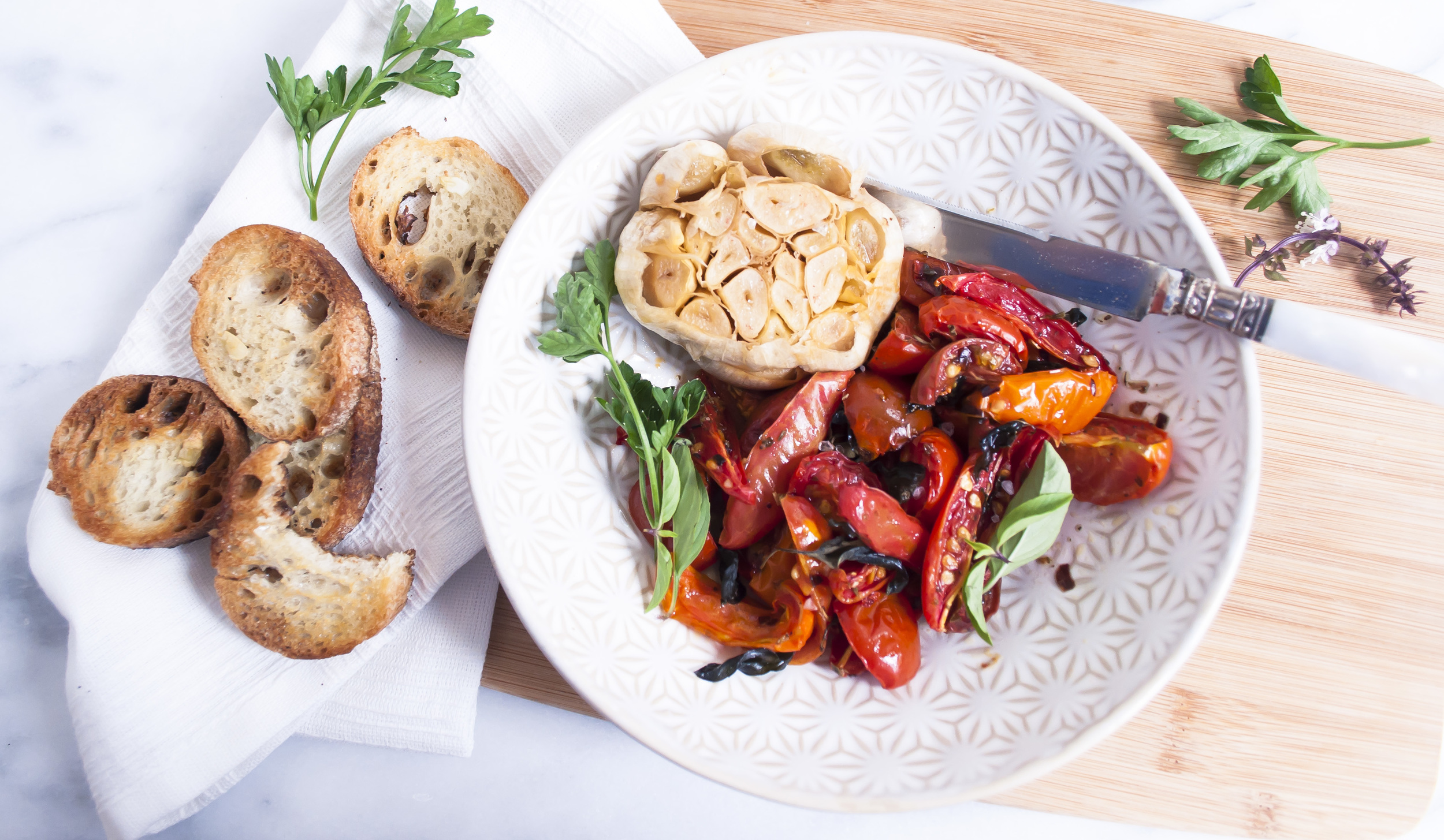 ROASTED GARLIC AND TOMATOES ON TOASTS