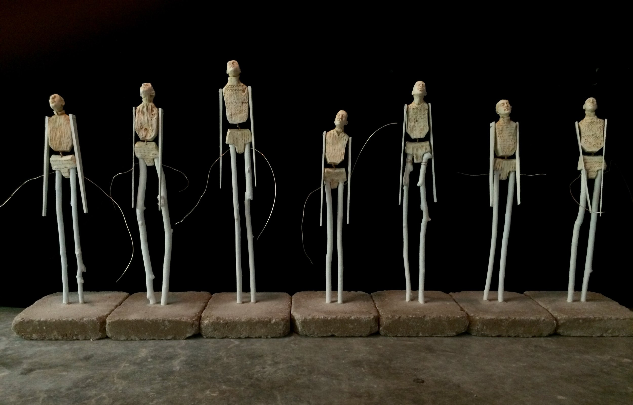 """The Stickleys, 16""""-22""""tall, fired clay and painted sticks"""