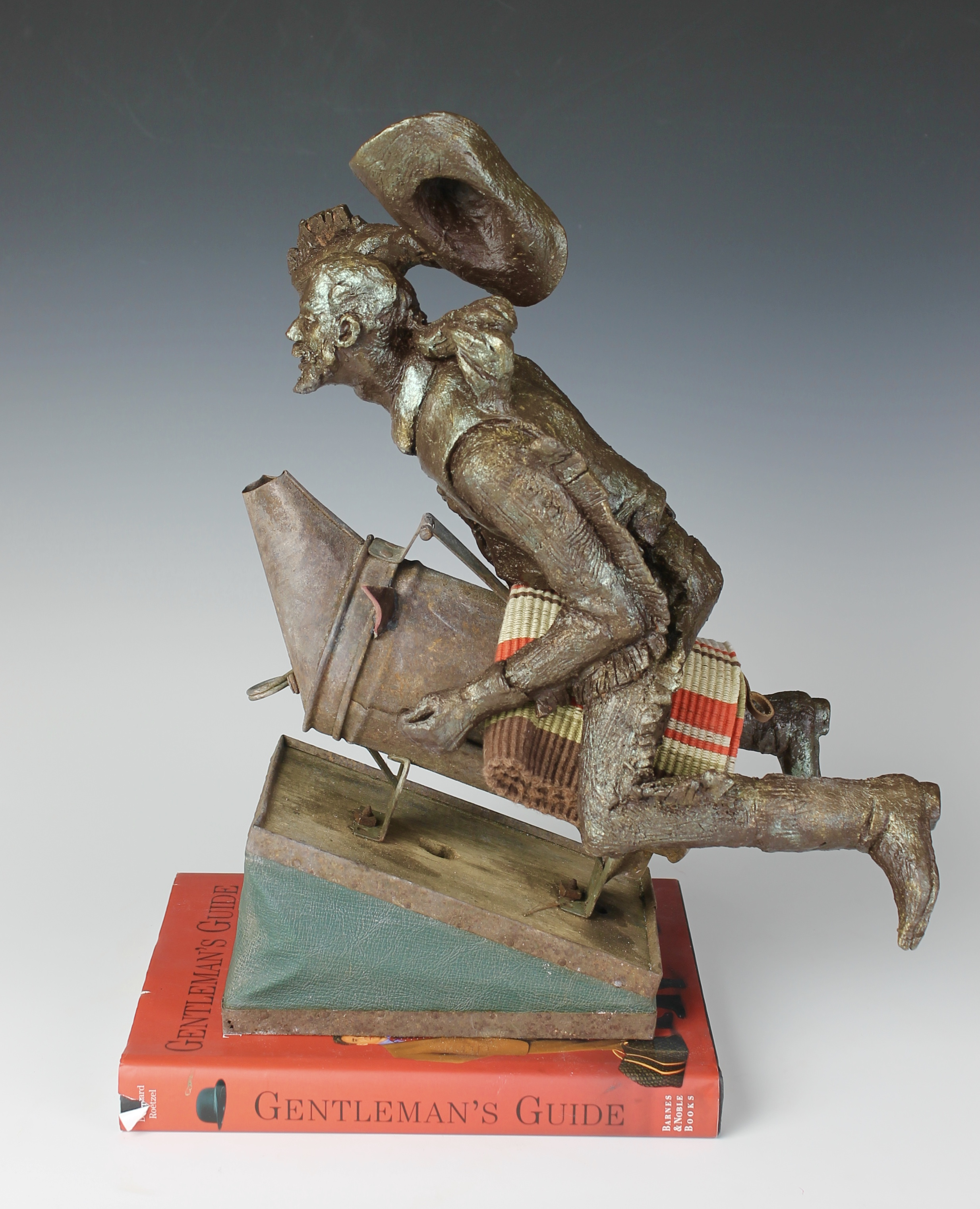 """Gentleman's Guide to Grooming and Style, Fired and painted ceramic, antique bee smoker, fabric and book, 15""""x11""""x10"""""""