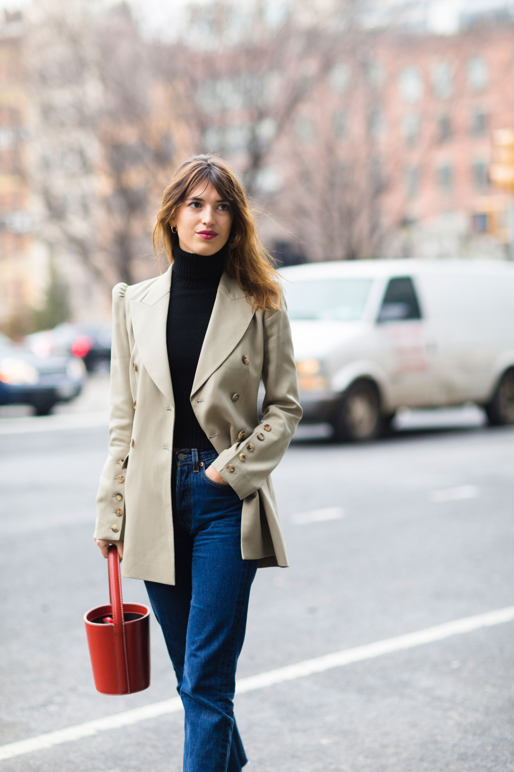 Image of Jeanne Damas, Photo by Nabile Quenum  Jeanna Damas is the queen of effortless cool and this look is no exception! The only thing that could make it better? Throwing on the  Long Tassel Lariat  over that sleek turtle neck!