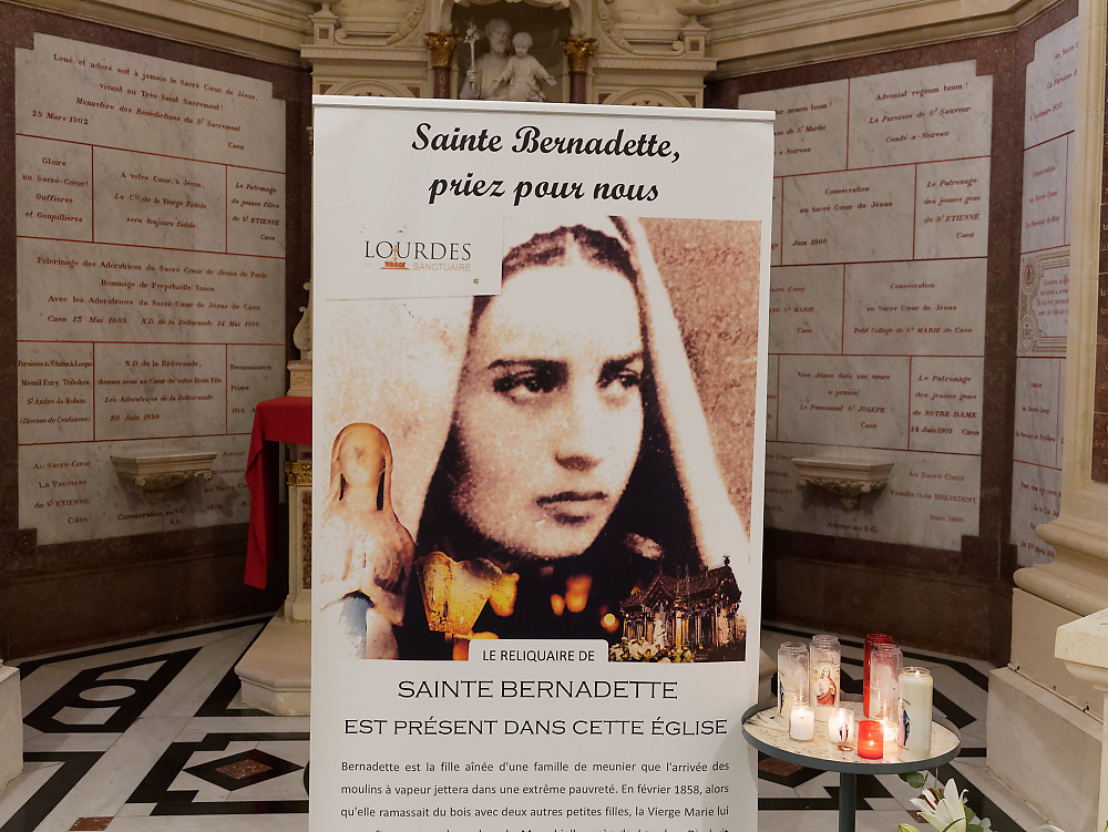 Poster announcing the presence of the relics of St. Bernadette of Lourdes
