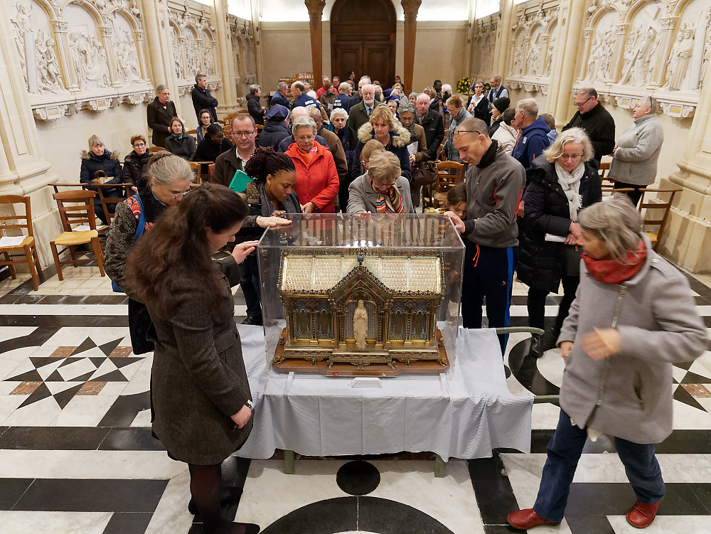 The faithful pray in the presence of the relics of St. Bernadette of Lourdes at the Monastery of the Visitation at Caen