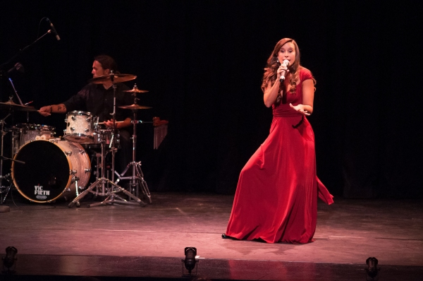 "Lauren performing ""The Girl in 14 G"""