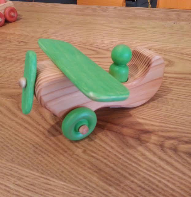 Wooden Airplane    -Locally handmade   $17.95    Wants 1