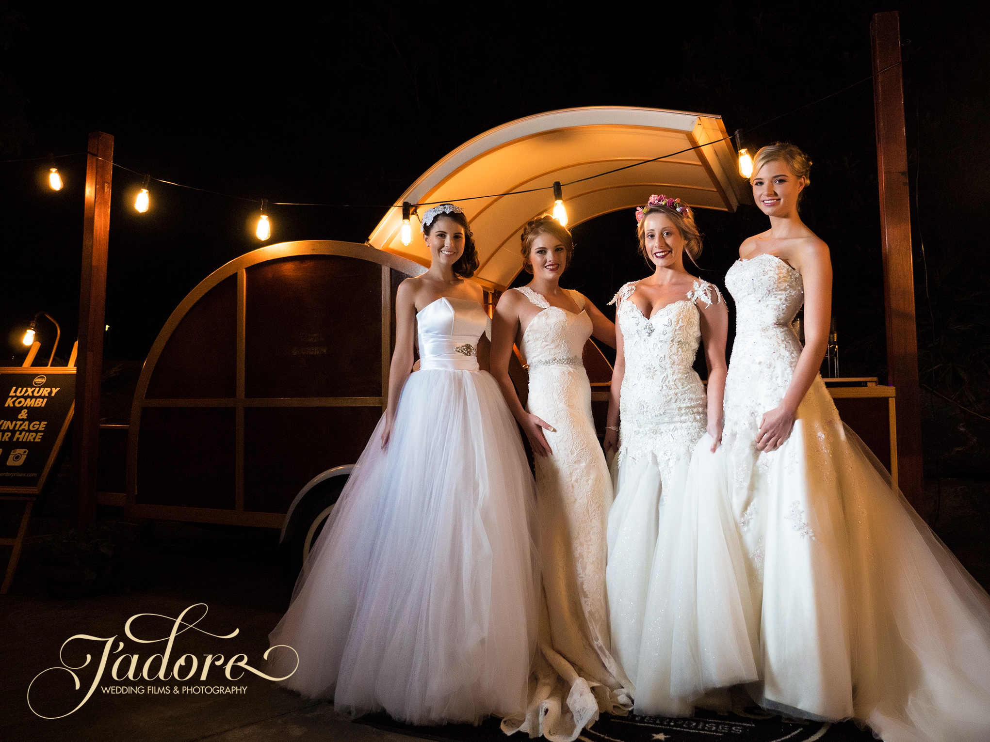 """From left to right Emily, Kate, Alana & Tanja all looking stunning in their  House of Serendipity Gowns in front of """"woody"""" the mobile bar from  Luxury of Vintage Enterprises"""