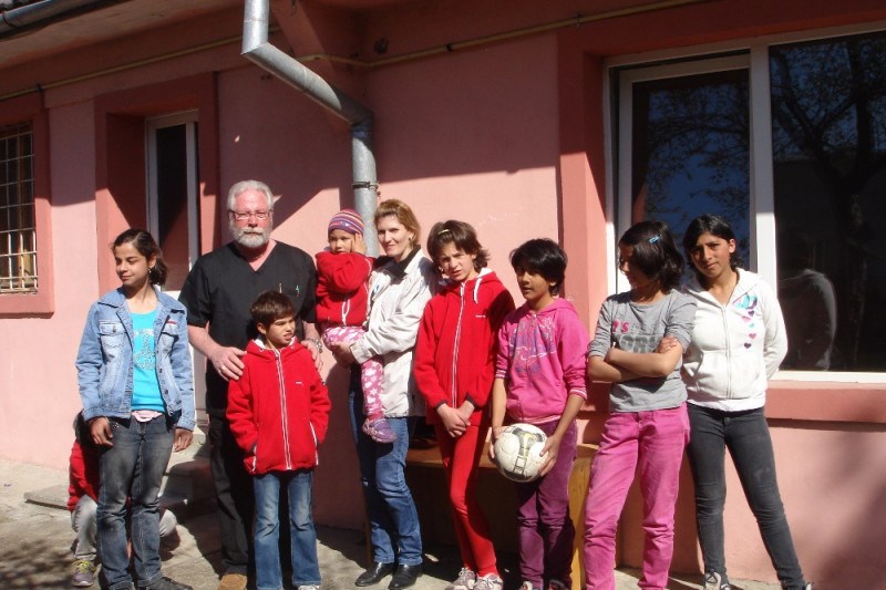 Dr. McQuillan with some of his Romanian patients