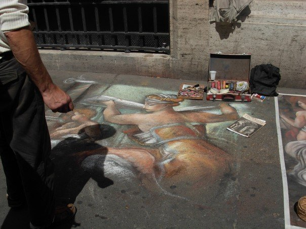 Sidewalk artist in Italy