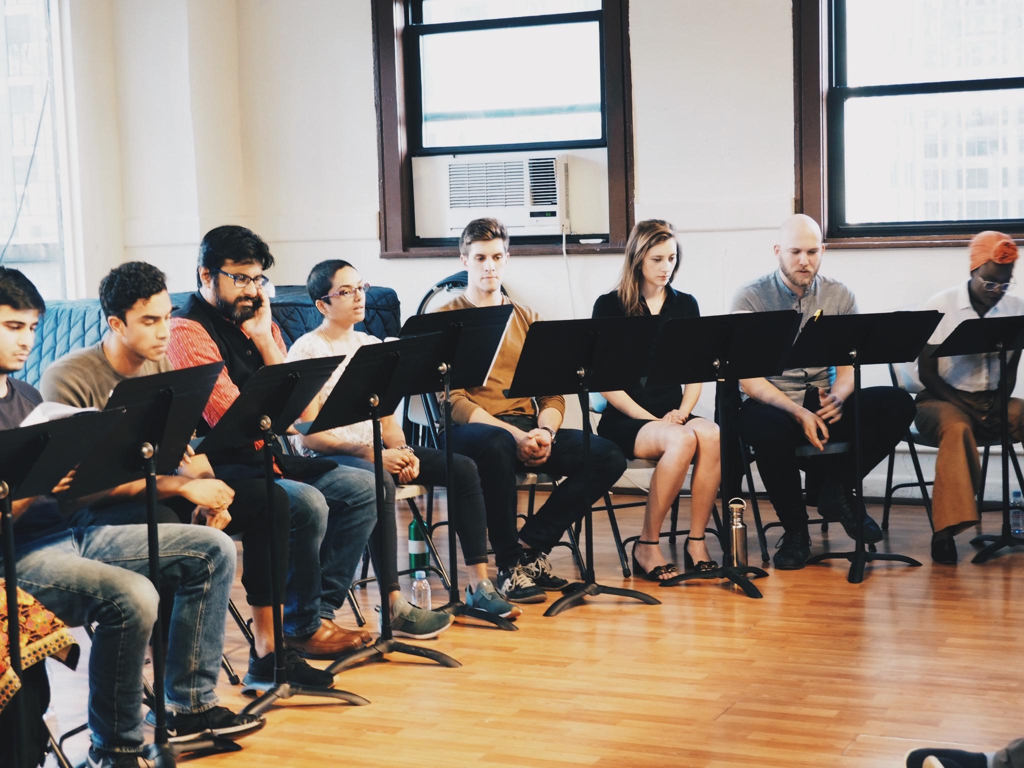 "From left: Rishi Mutalik as ""Yusuf"", Anish Roy as ""Saleem"", Nitin Madan as ""Faisal"", Ishani Das as ""Saima"", Alec Bandzes as ""Julian"", Hannah McGovern Gross as ""Amanda, Erik LaPointe- Ensemble, and Adeola Role as ""Sarah Sullivan"""