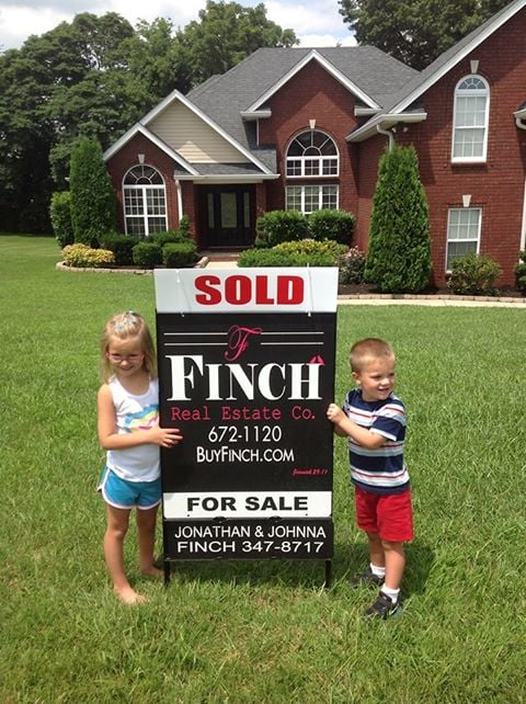 chad and michele sold picture with kids.jpg