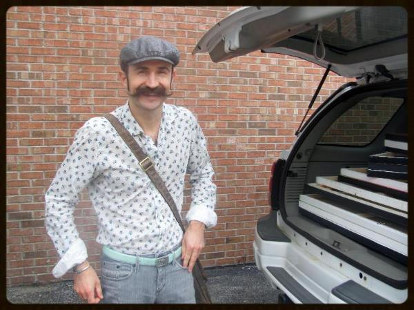 A carload of canvases - and can you see the excitement under that mustache?