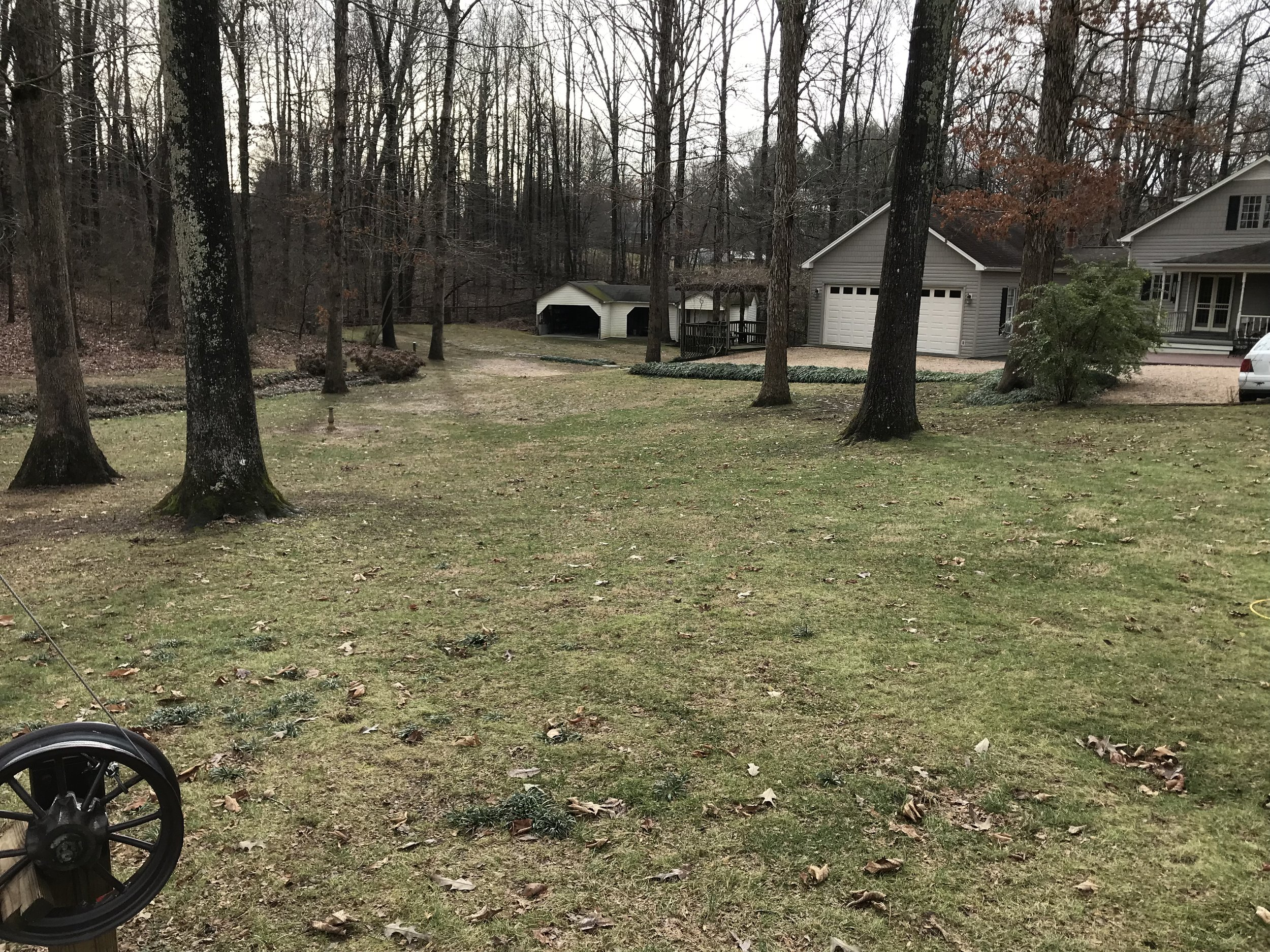 This is photo 10. Looking back down the side yard towards Lot 47 and the back yard.