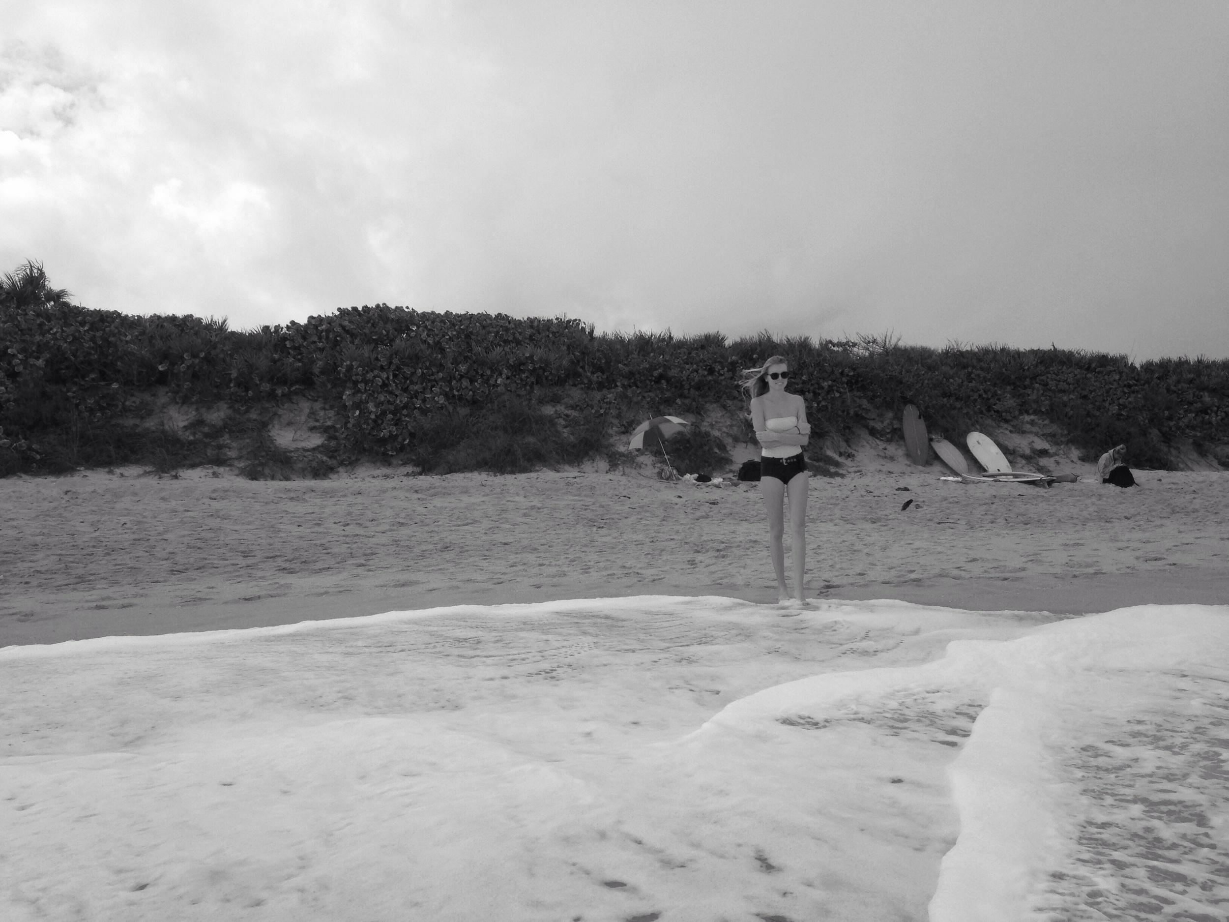 Tatum enjoying the sand & salt.