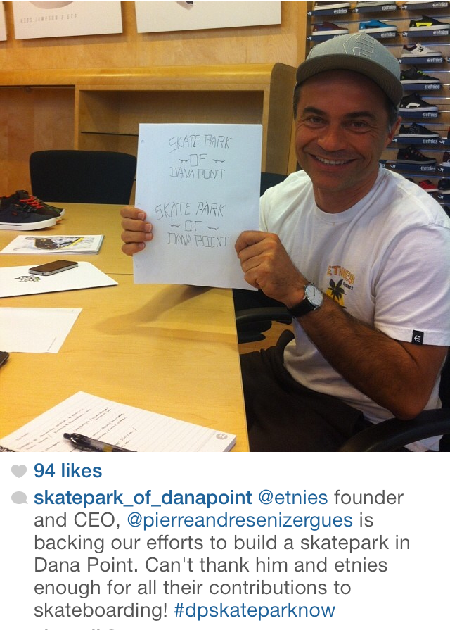 Pierre Andres holding up the T-Shirt design for the Skatepark of Dana Point Efforts.