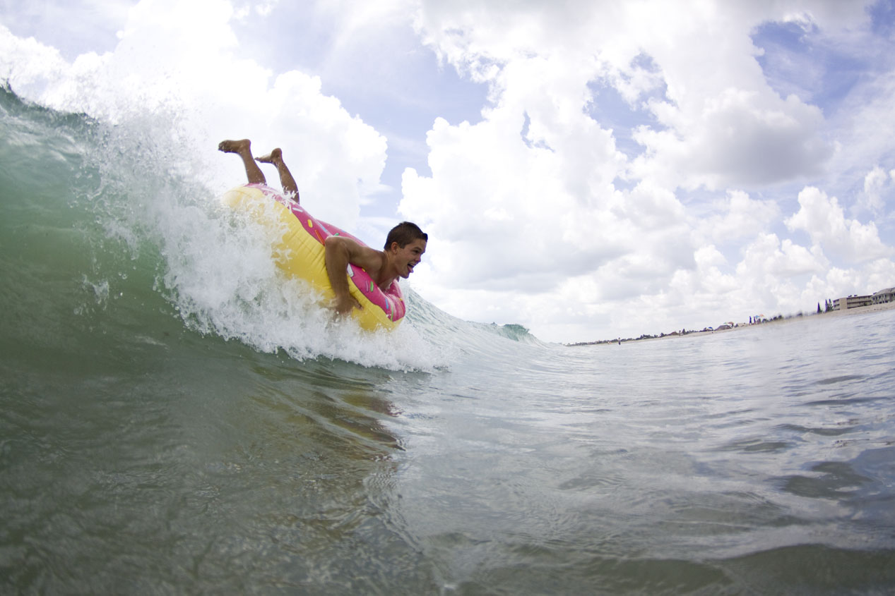 Jakeh Bradley dropping in on the shorebreak with a donut! I always knew that surfing and donuts made sense...