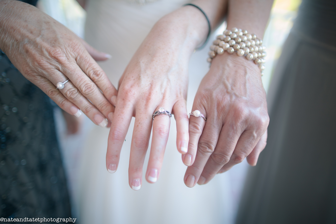 The Bride, Mother of the Bride and Mother of the Groom. The Mothers are both wearing the beautiful rings that the Bride had made for them as a special gift.