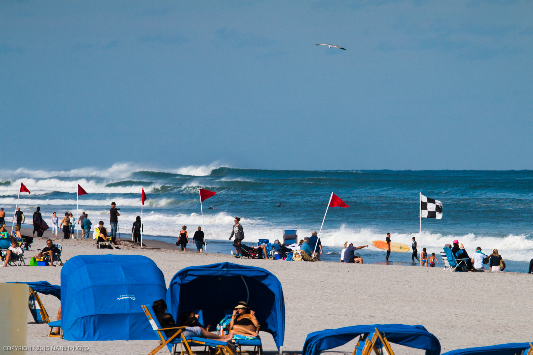 Watching these sets roll in from miles away was pretty cool, at least I thought so. However these people strategically placed there shade canopy as an anti-surf canopy.