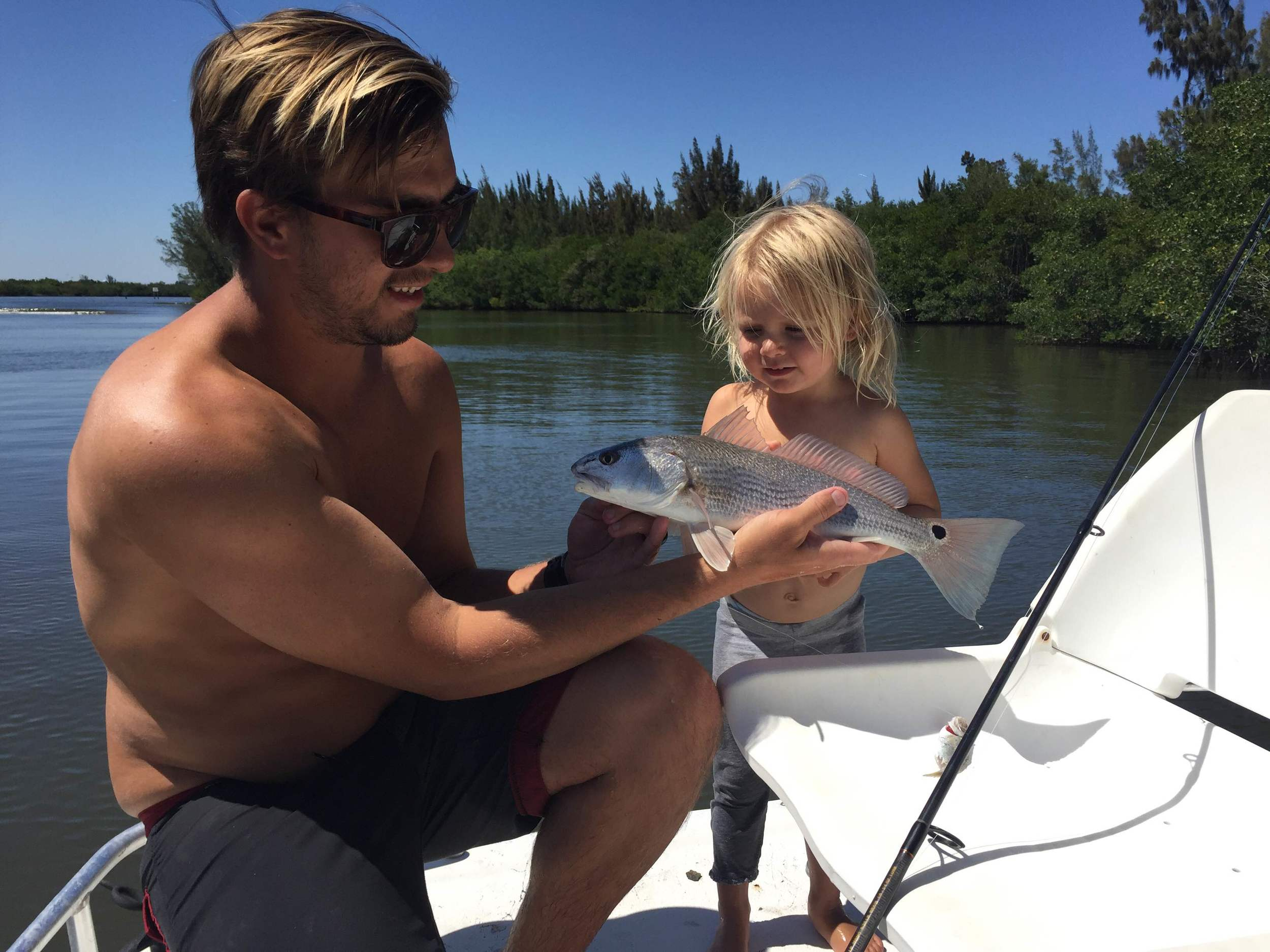 Nathaniel Harrington and River Harrington with a Snook_ Florida Boat Rentals_ver beach_ Florida