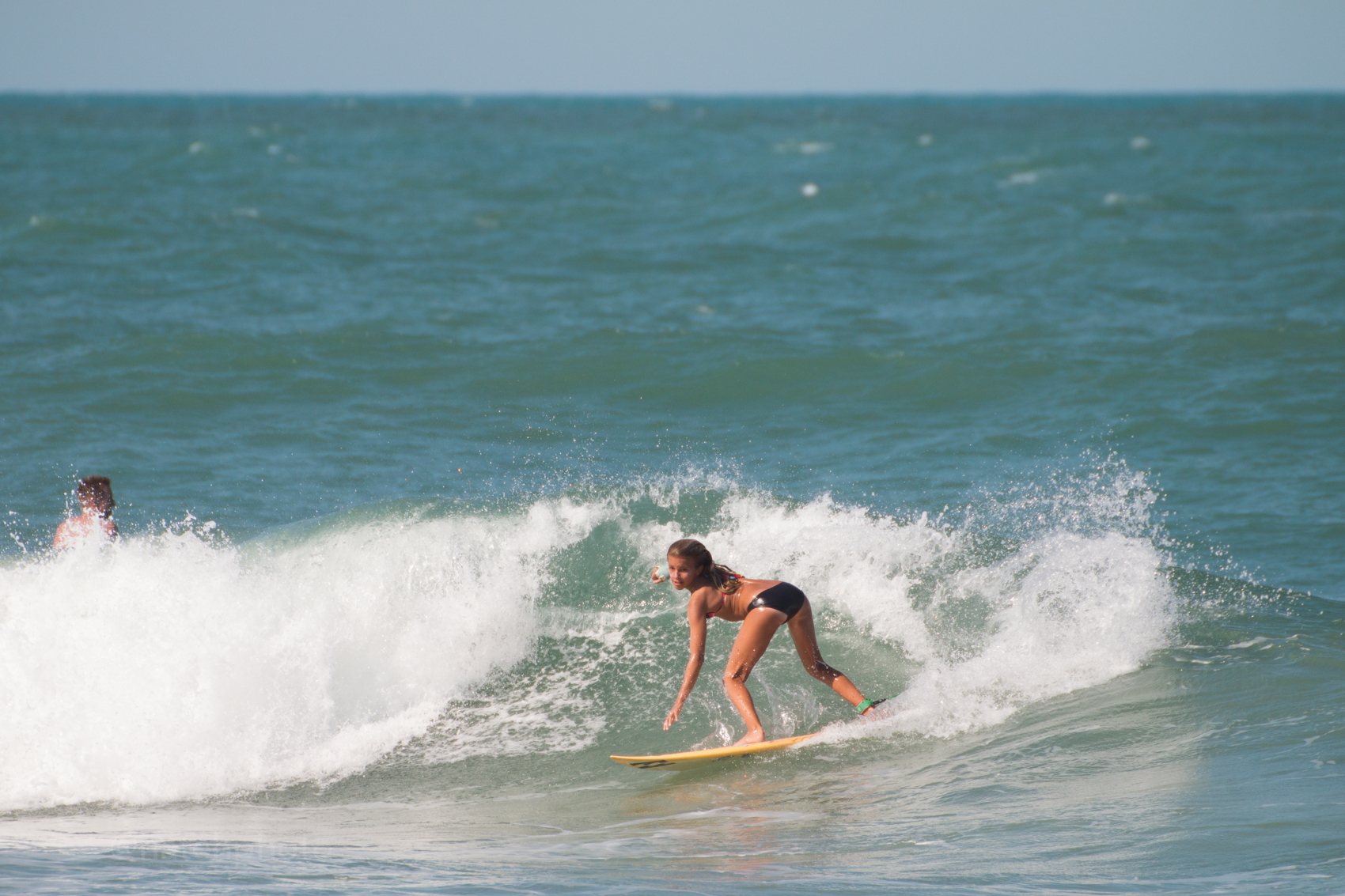 Zoe surfing sebastian inlet, photo by Nathaniel Harrington