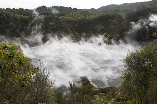 A wide trail descends alongside Echo Crater and its steaming waters.