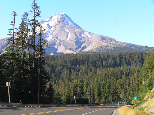 A scenic roadway with Mt Hood in the near distance.