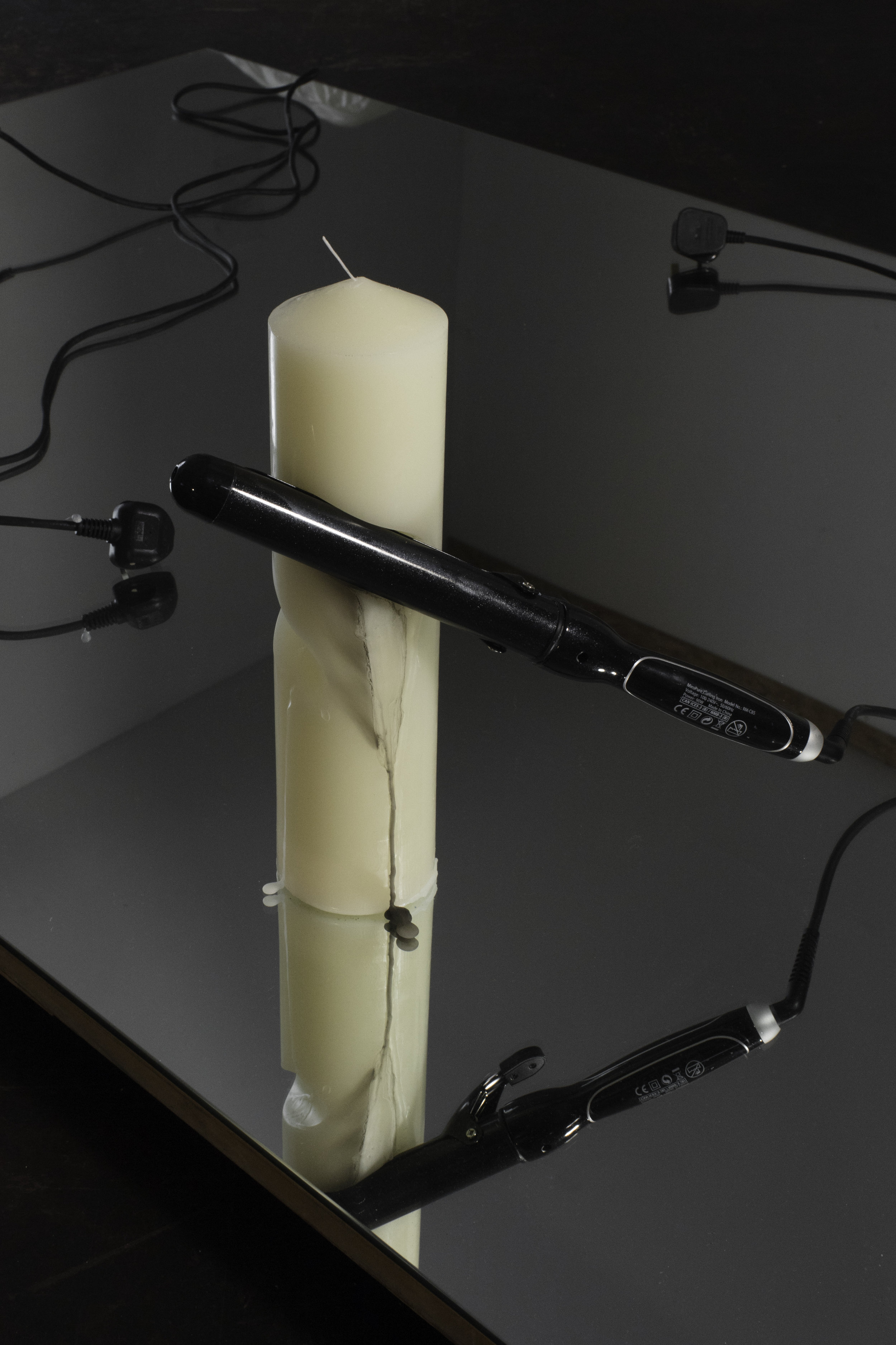 controlled burn   candle and curling iron