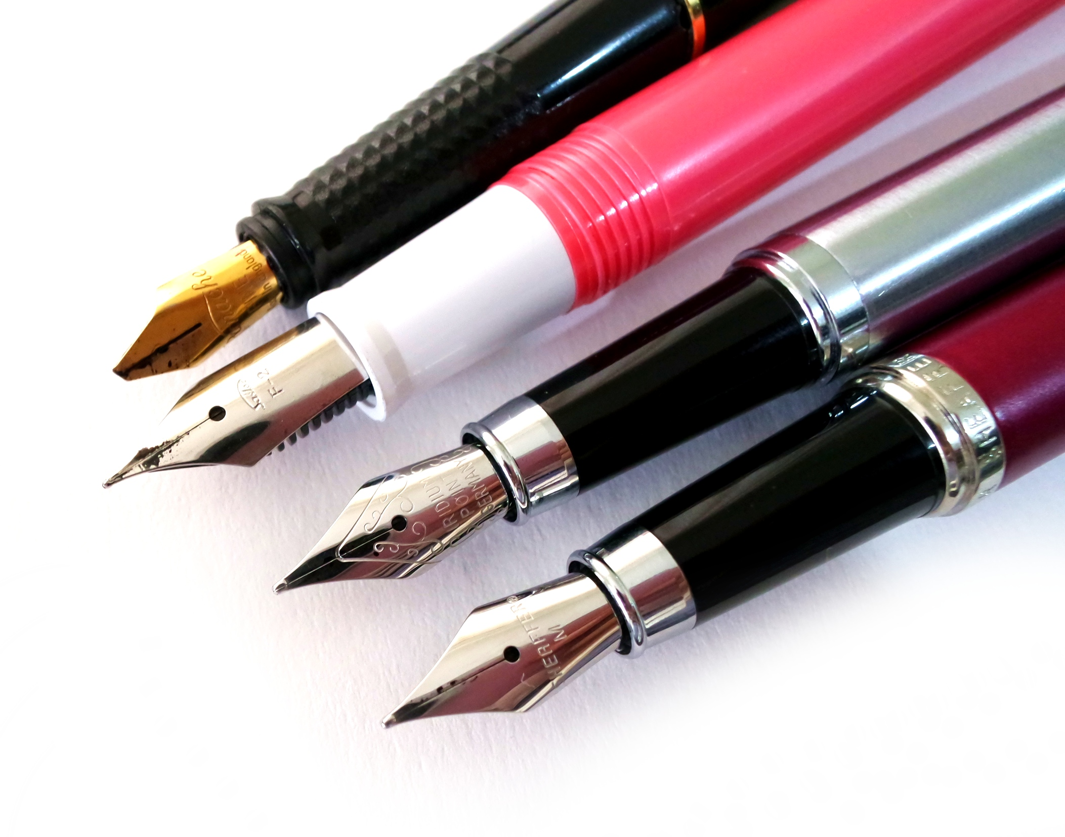 Fountain pen cabal: Panache, Sailor, nameless fountain pen from National Bookstore, and Sheaffer