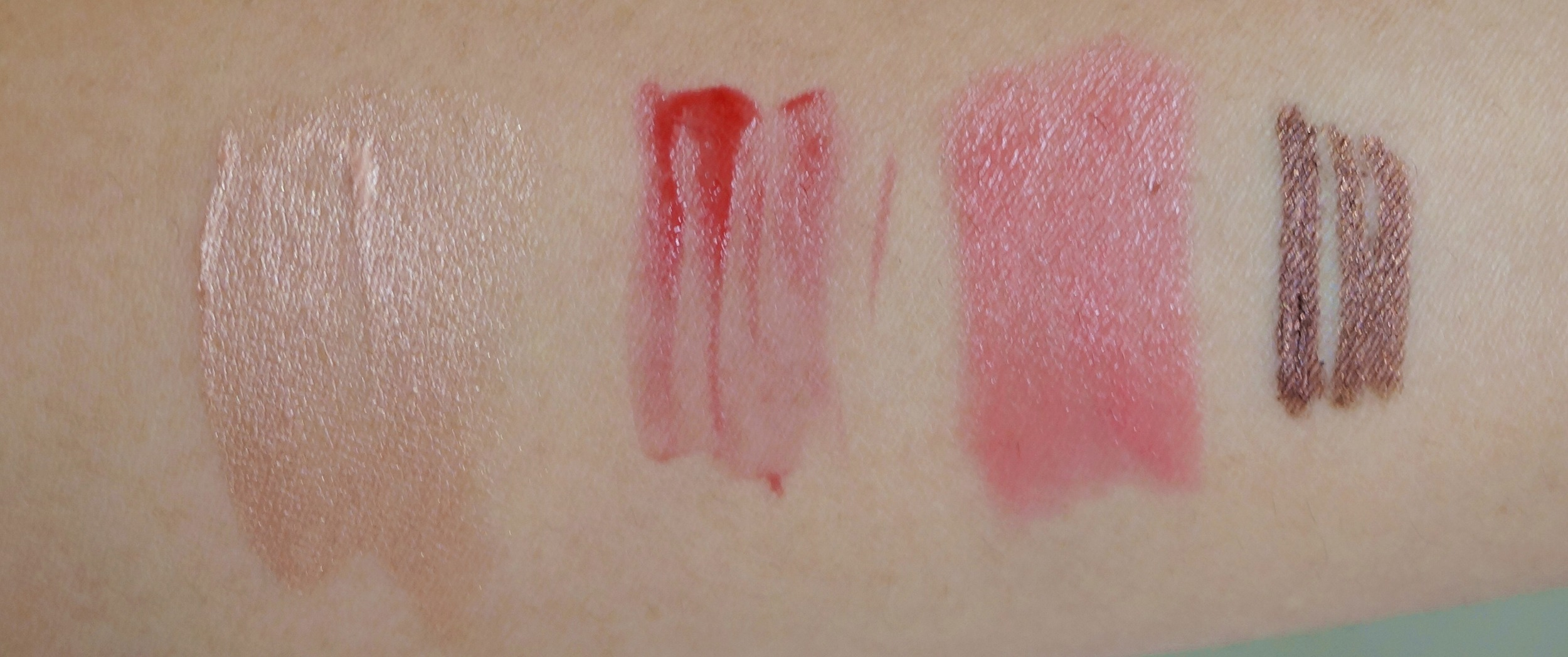 Swatch of the Flawless Primer, Sheer Cheek Gel in Flushes, Tinted Brilliance Balm in Baby Bare, BronzeBeam eyeliner