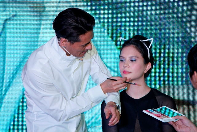 Shu Uemura international artistic director Kakuyasu Uchiide applying the Parisienne chic cat eye make-up on model Jess Wilson