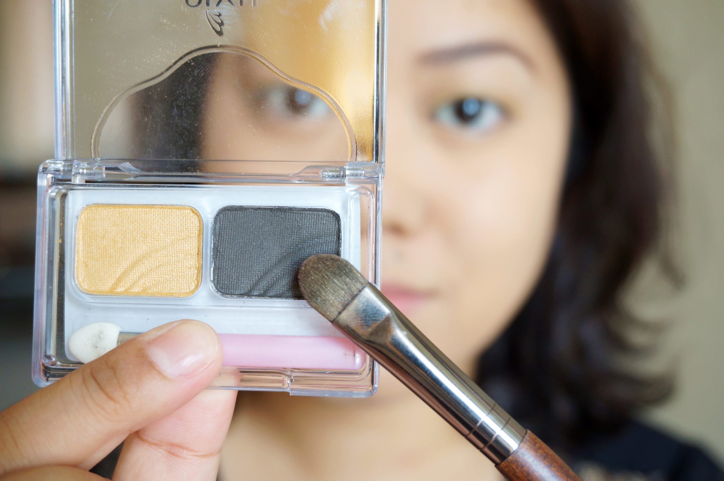 Step 6: Pick up the charcoal black from the palette and map out the shape of your smoky eye. I like mine dark on the crease with a slight winged v on the outer corner of my eye.