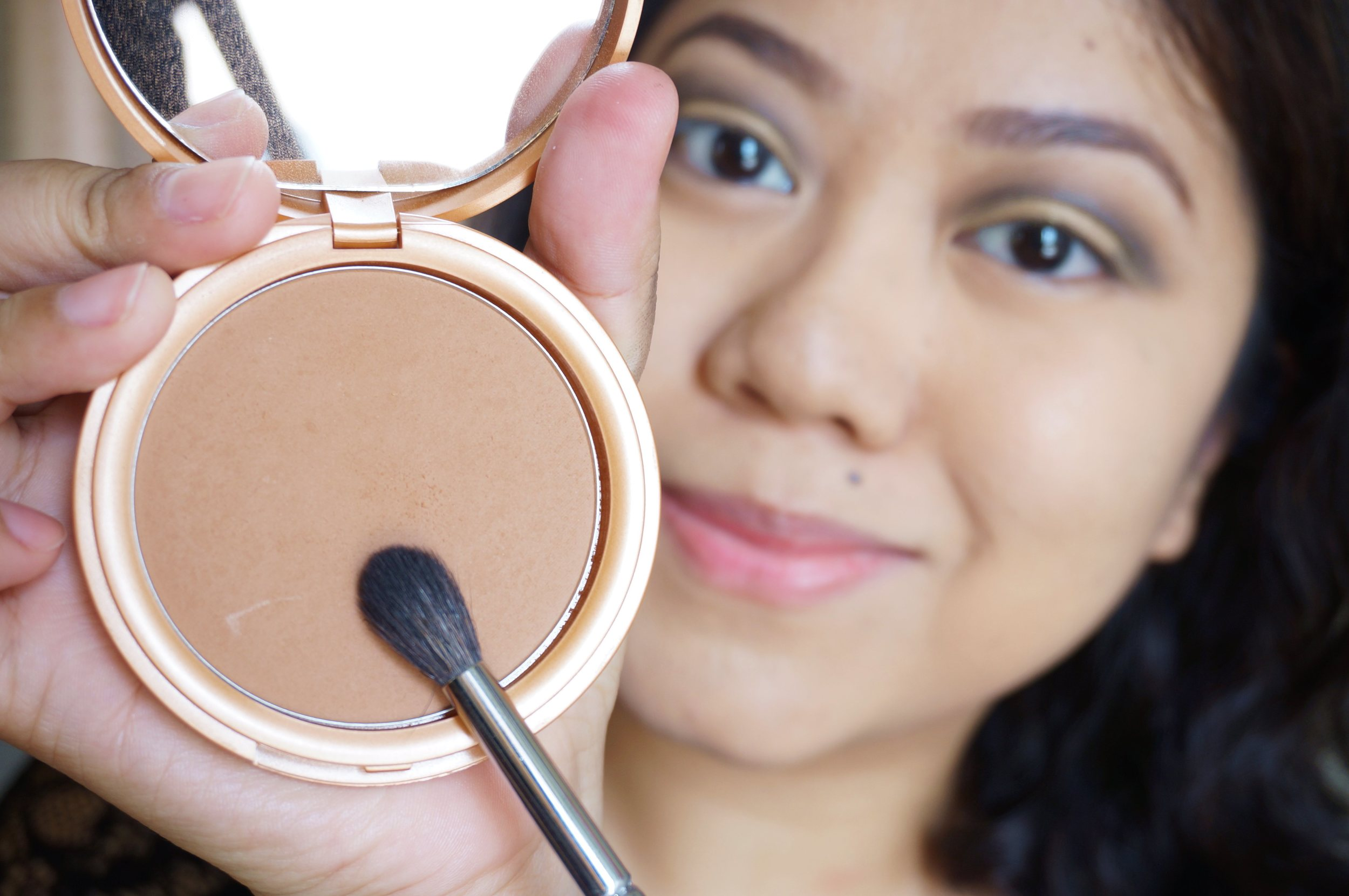 Step 7: Now you've got your smoky eye shape, you need to blend that out with a matte, brown contour shade. You want the edges to soften up!