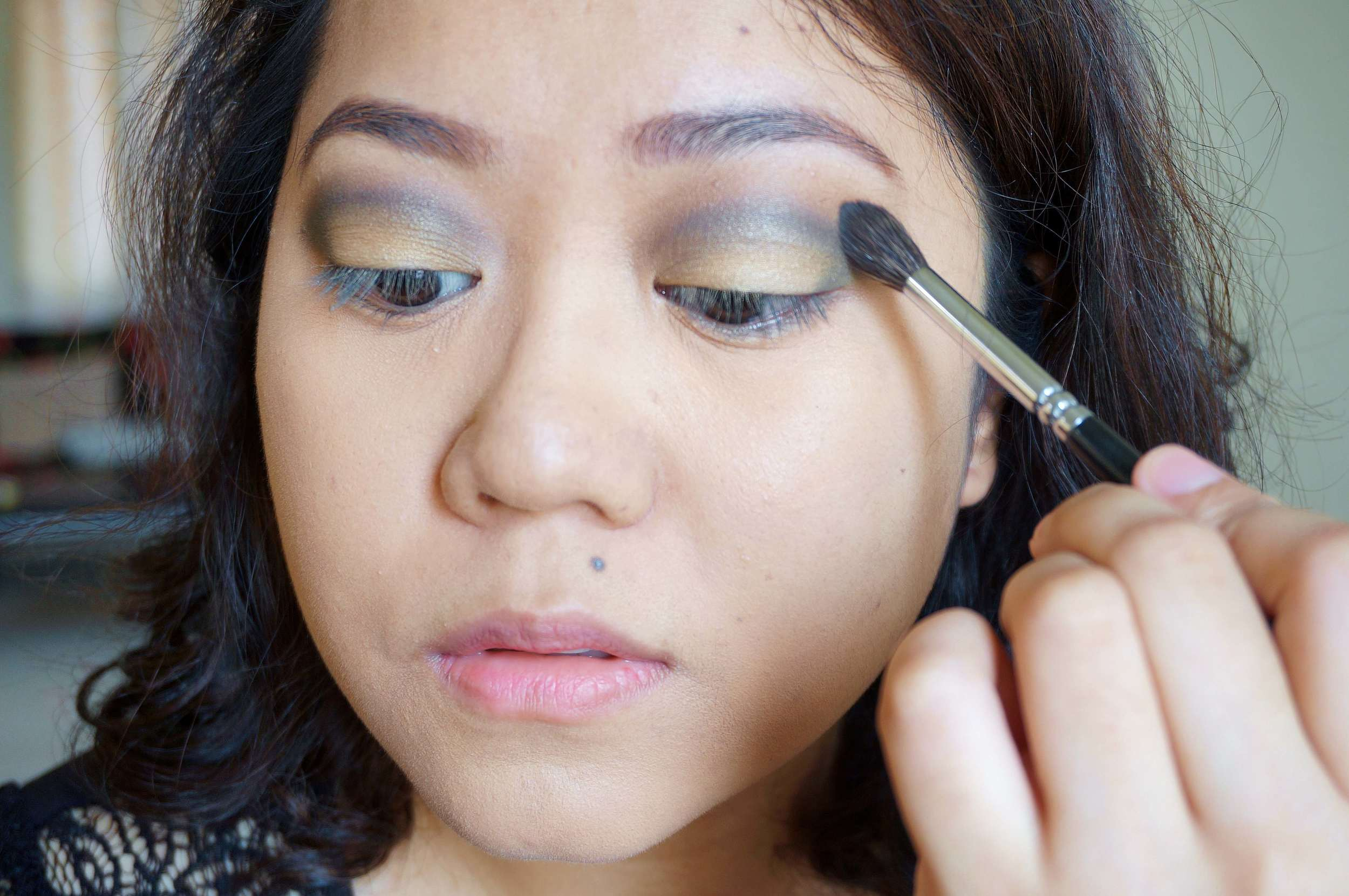 The best brush for this is a fluffy, animal hair one with a domed tip. Apply the blending shade right on the outer edges of the smoky shadow and just blend away!
