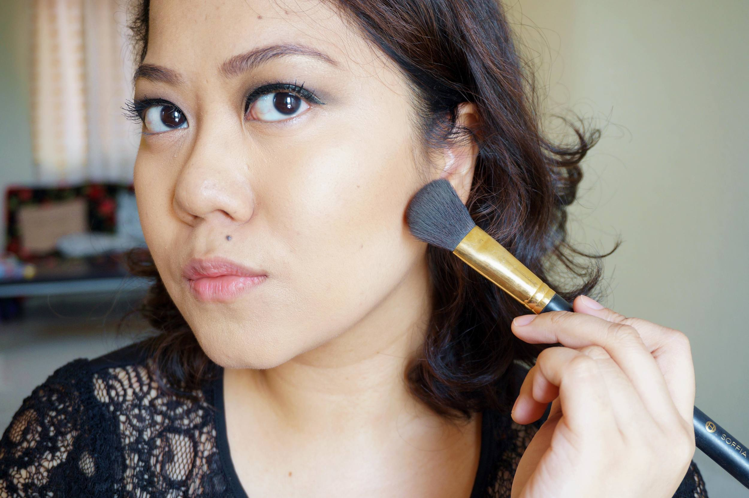 Your contouring should be barely visible, but should show up. The key is to blend out any harsh edges with a clean brush when you're done.