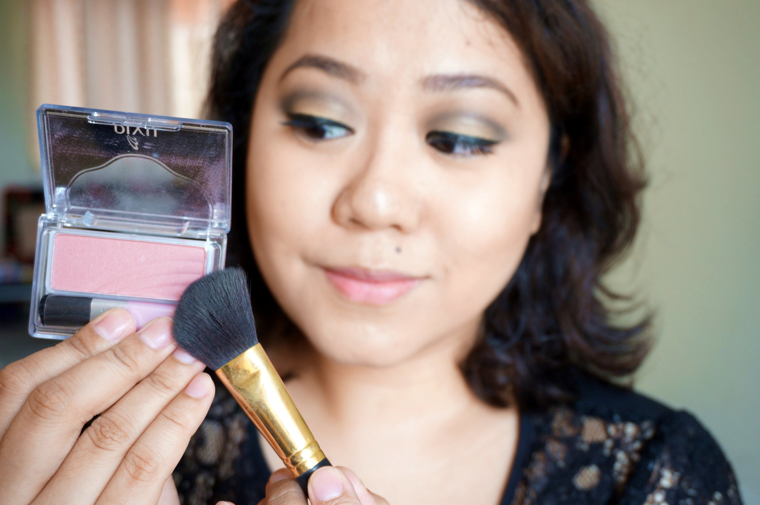 Step 12: Layer on the Pixy Passion Roses Brush (P285) on the apples of your cheeks. This gives a natural flush with just ahint of shimmer. It's very pretty and understated!