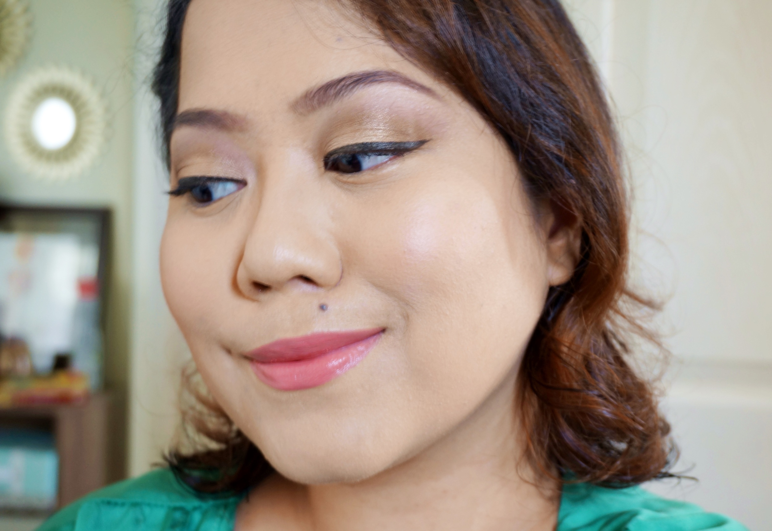 In this look, I used the taupe brown on the 2nd column, 2nd row on my eyebrows. I applied the gold (3rd column, 2nd row) all over my lids, then blended the bronze (4th column, 1st row) on my crease. I added a tinge of the black (6th column, 2nd row) on the outer v for a bit of definition. Finally, I placed the matte beige (3rd column, 1st row) right underneath my brows.