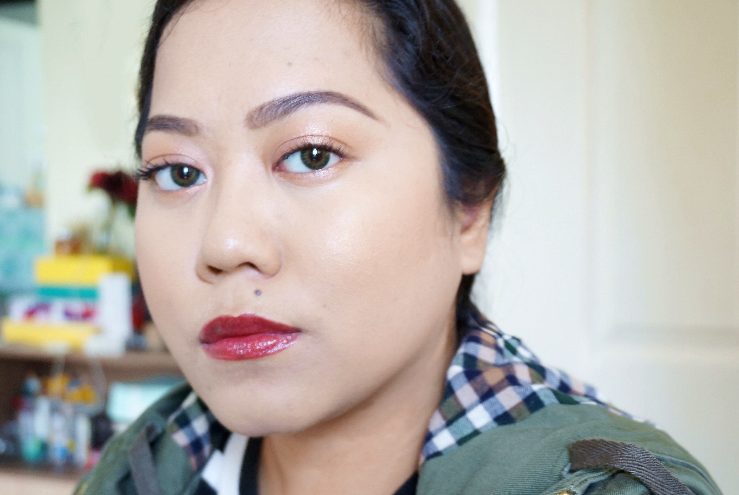 Here's a light way to wear dark lipstick: place a light pink shadow all over your lids, load on the lashes, and highlight your cheekbones. Looks fresh right? Try it one time. ;)