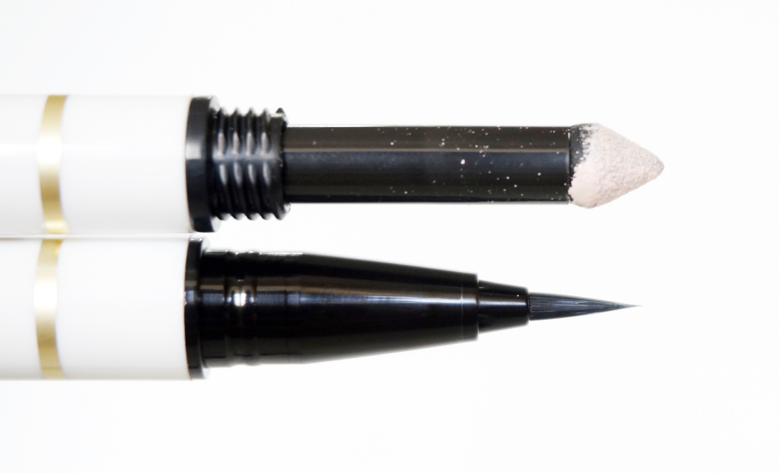 The sponge tip is the same as the one in their eyebrow duos. It's a bit challenging to maneuver around the lids at first, but it's pretty easy once you get the hang of it. I like drawing a thick brown line on my lids, with a slight wing, and then topping it with the paired eyeliner.