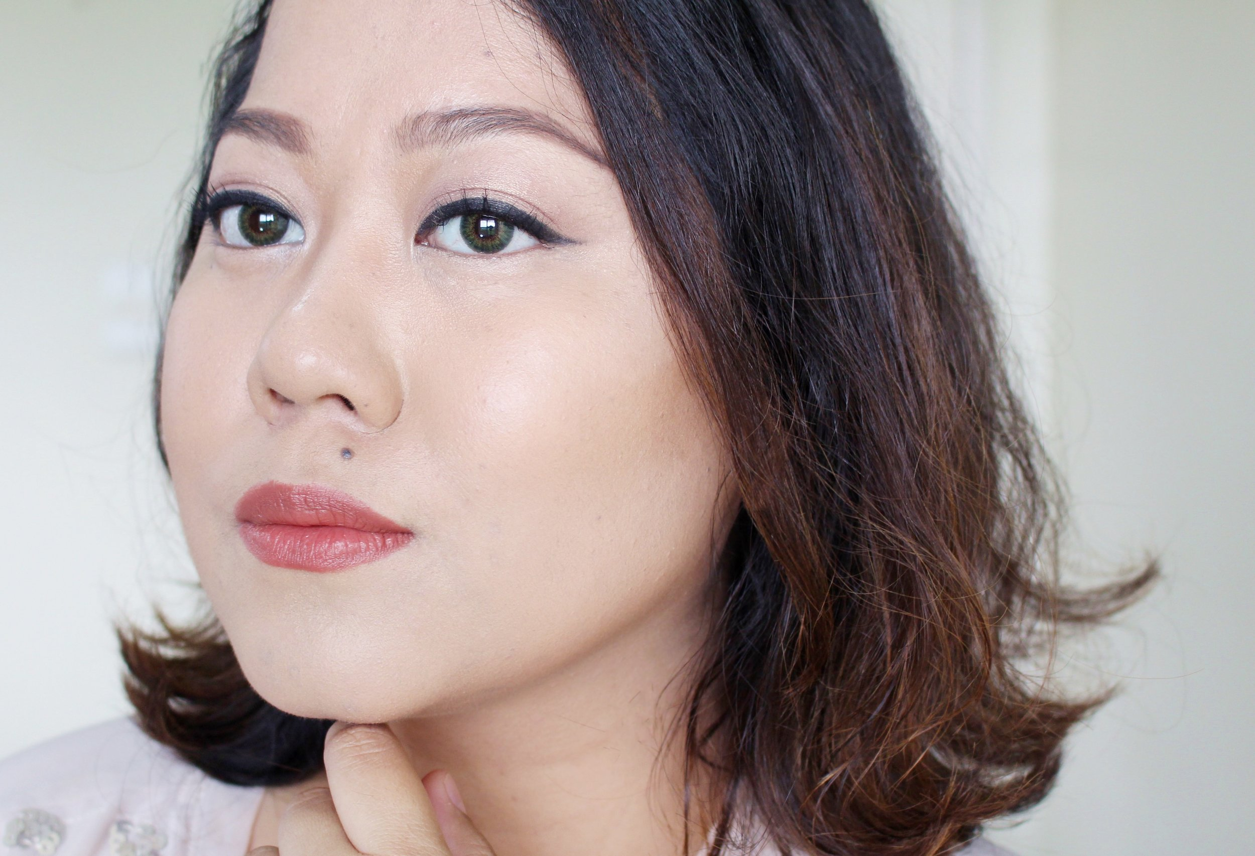 Wearing the Essence Pure Nude  on the bridge of the nose and cheekbones. Love how it's almost imperceptible but the glow is there.