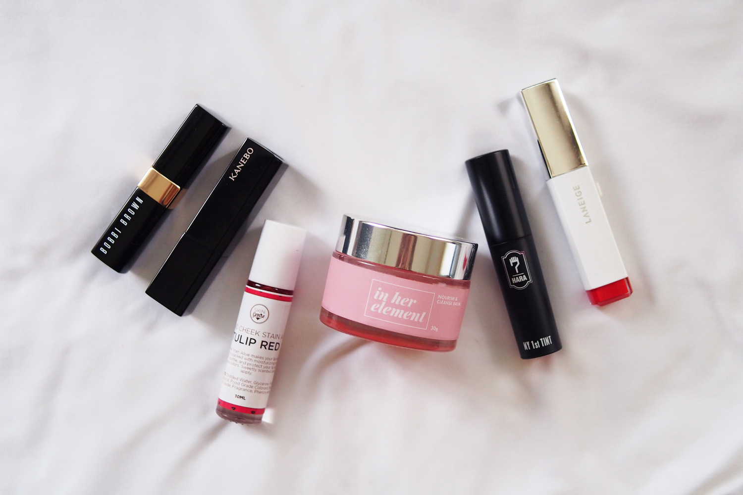 Bobbi Brown Nourishing Lip Color  in Island Pink (P1,400),  Kanebo Moisture Rouge in 05 Core Red  (P2,100), Skin Genie Lip and Cheek Stain Alive in Tulip Red (P80 via BeautyMNL.com), In Her Element Nourish & Cleanse Balm (P595), 7Hara My 1st Tint in Maple Red (P350 via Althea Korea), Laneige Two-Tone Lip Bar in No.5 Daring Darling (~P1,200)