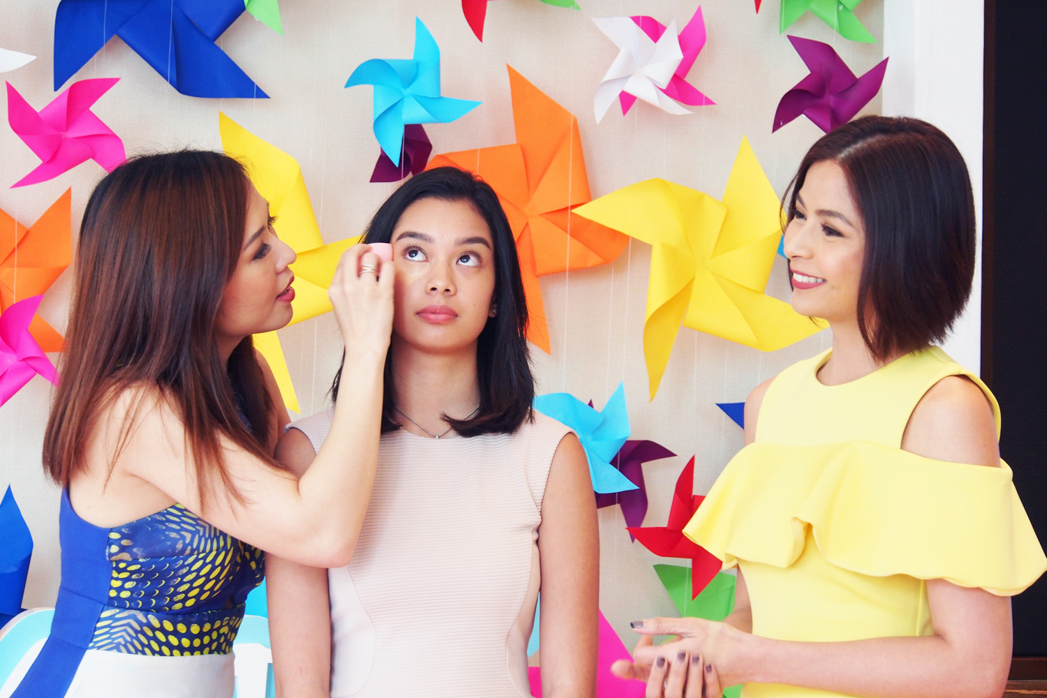 Happy Skin founders Jacqe Yuengtian-Gutierrez and Rissa Mananquil-Trillo demonstrating the transforming powers of the Bye Bye, Blues Brightening Concealer Wand