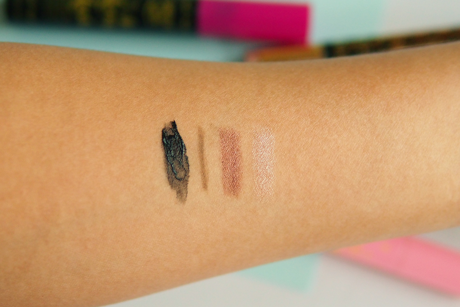 Swatches, from left:At Long Lash Supercurl Waterproof Mascara, Eye Love View Too Microtip Eyebrow Pencil & Spoolie Duo, Say Eye Do Easy Eyeshadow Cushion Duo in Espresso and in Champagne