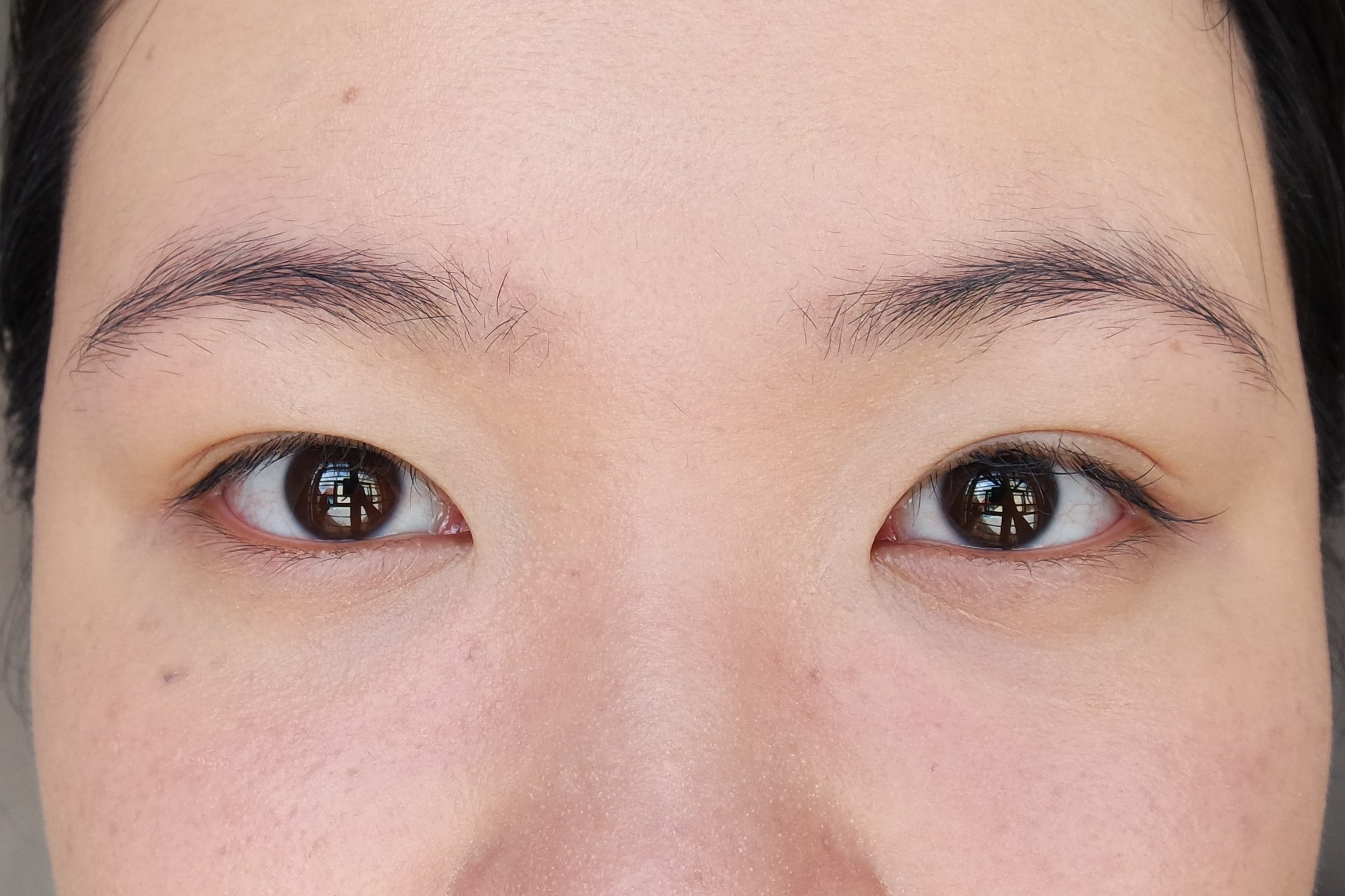Applied concealer with (from left) a wet sponge and a dry sponge